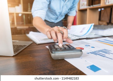 Businessman  or accountant using calculator to calculate budget planner, Business financial concept.