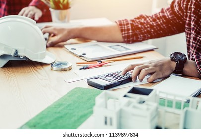 Businessman accountant using calculator and laptop for calculating finance on desk office. business financial accounting concept.