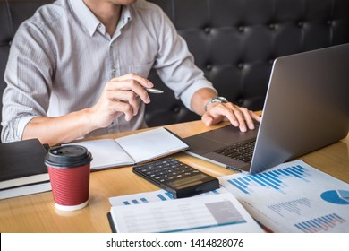 Businessman accountant working audit and calculating expense financial annual financial report balance sheet statement, doing finance making notes on paper checking document.