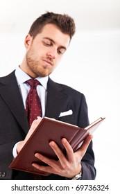 Businessman accounting on his agenda