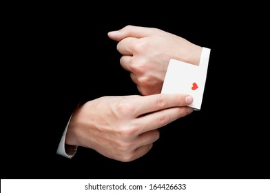 Businessman with ace card hidden under sleeve isolated on black