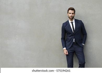 Businessman against the wall, portrait