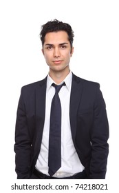 Businessman against a white background with hands in his pockets