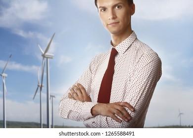 Businessman against the wind turbines