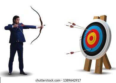 Businessman aiming arrow with bow