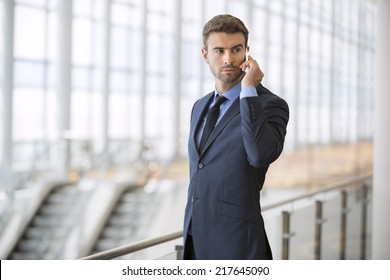 businessman at the airport with mobile phone