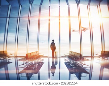 Businessman at airport with suitcase