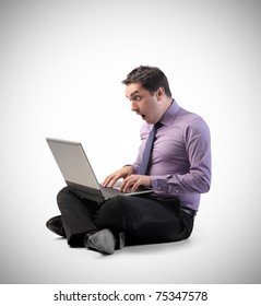 Businessman with amazed expression using a laptop