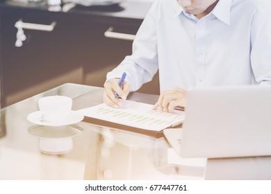 Businessman analyze project finance on modern office concept
