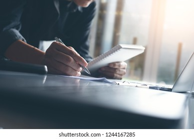 Businessman analyzes business data, financial report and working on laptop computer in office, business strategy analysis, business profits review concept, close up
