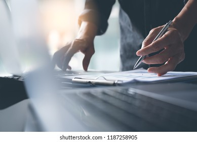 Businessman analyzing business data, financial marketing report and working on laptop computer in office, business strategy analysis, business profits review concept, close up