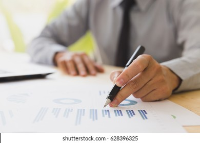 Businessman analyzing charts and graphs with modern laptop computer in office. business analysis and strategy concept.
