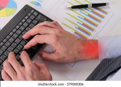 Businessman analyzing data. Close up of man hands typing on computer keyboard