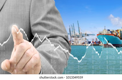 Businessman analyzing financial chart on virtual screen, in the background container terminal with cargo ship