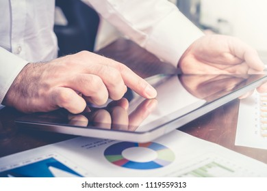Businessman Analyzing Financial Statistics With Tablet