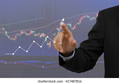 Businessman analyzing graph for trade stock market