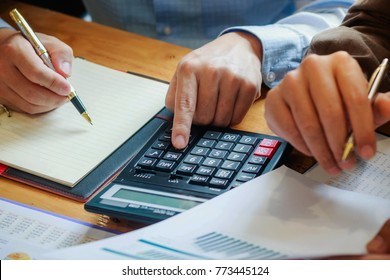 Businessman analyzing investment charts with . Accounting