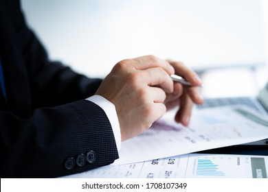 Businessman analyzing investment charts with laptop. Accounting concept