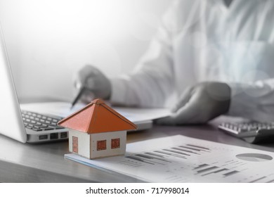 Businessman analyzing investment charts on the desk. pen in hand