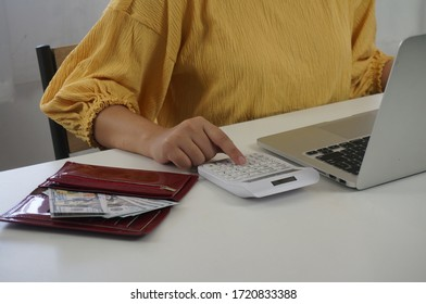 Businessman analyzing investment charts and pressing calculator buttons over documents. Accounting Concept Saving Economy concept.