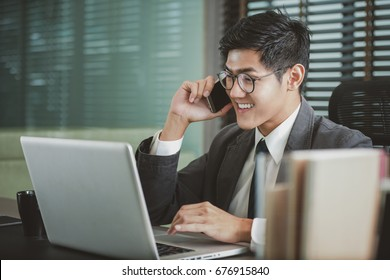 Businessman analyzing investment charts with Smartphones and laptop. Accounting