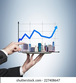 Businessman analyzing real estate market