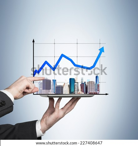 Businessman analyzing real estate market