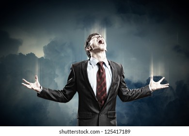 businessman in anger screaming against cloudy background