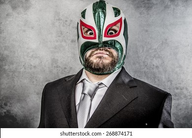 businessman angry with Mexican wrestler mask