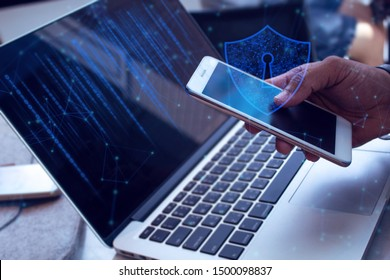 businessman with anti-virus shield icon digital telecom online, smartphone mobile and laptop notebook computer in network social online connect to data ai concept, risk market trade working
