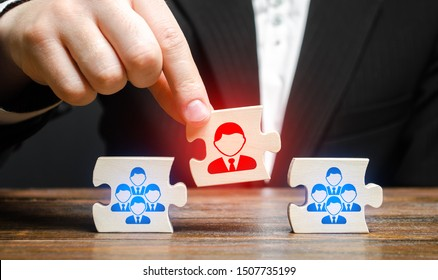 A businessman appoints a leader to the head of the team. Creation of an effective teams of specialists for the implementation of a new project. HR recruiting. Management appointment. nepotism