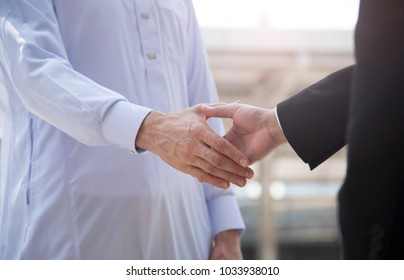 businessman arabic with engineer making handshake agreement. concept partner to business.