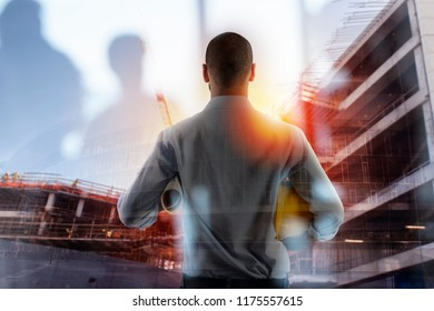 Businessman Architect analyzes the works of a building. double exposure