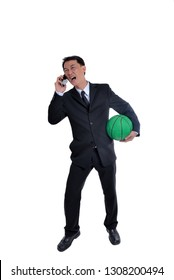 Businessman argue on phone and holding ball in his hand.