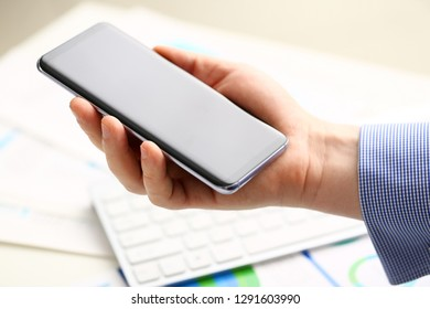 Businessman arm using modern cell phone closeup. Stock market trade and investment wireless ip telephony data search wifi connection inspiration idea web surf new browsing communication lifestyle