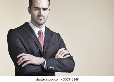 Businessman with arms crossed isolated
