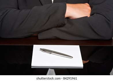 Businessman with arms crossed in a meeting