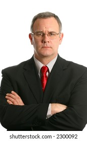 Businessman with arms crossed and serious expression