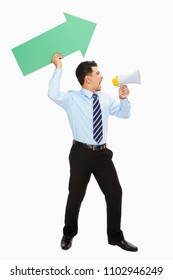 Businessman with arrow shouting into a megaphone