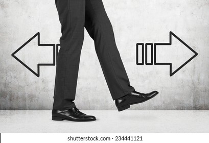 Businessman and arrows 'left or right'. a person is making a step.
