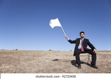 businessman asking for surrendering holding a white flag