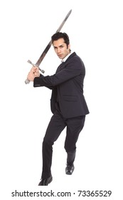 Businessman in attacking posing with a sword