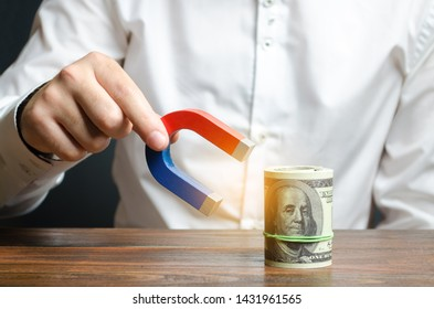 Businessman attracts money with a magnet. Attracting money and investments for business purposes and startups. Increase profits and attract new customers. Salary, bonus, cashback. Business strategy.