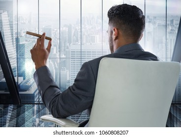 Businessman Back Sitting in slick Chair with cigar and window overlooking modern city