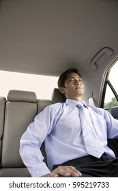 Businessman in backseat of car