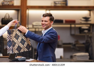 Businessman with bag at a counter