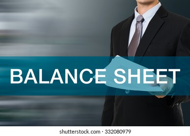 Businessman with BALANCE SHEET WORD