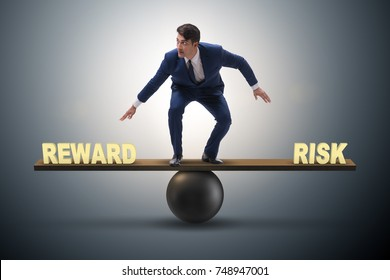 Businessman balancing between reward and risk business concept