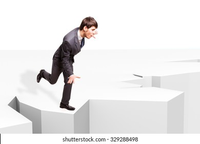 businessman balancing to not fall into an abyss