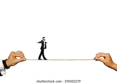 businessman balancing on the rope. isolated on white background